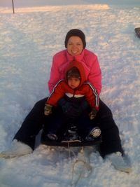 Noah and Mommy sledding